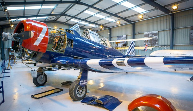 Hurricane Heritage's Harvard trainer plane, nicknamed 'Checker Tail, in the hangar at Old Warden